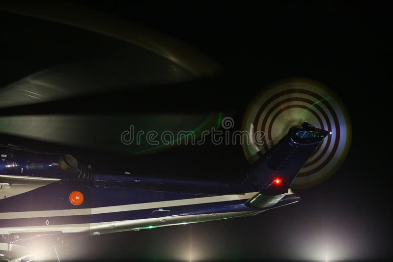 Helicopter landing in offshore oil and gas platform on deck or parking area. Helicopter night flight training of pilot.  royalty free stock images