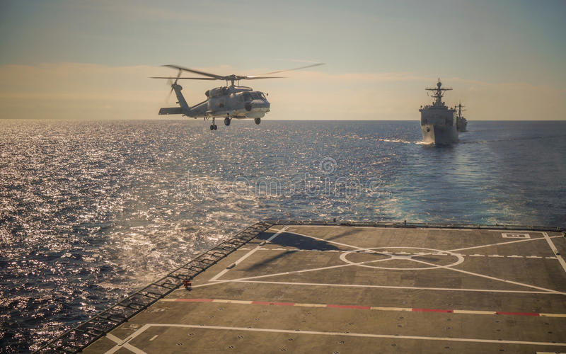 Helicopter landing on warship royalty free stock photo