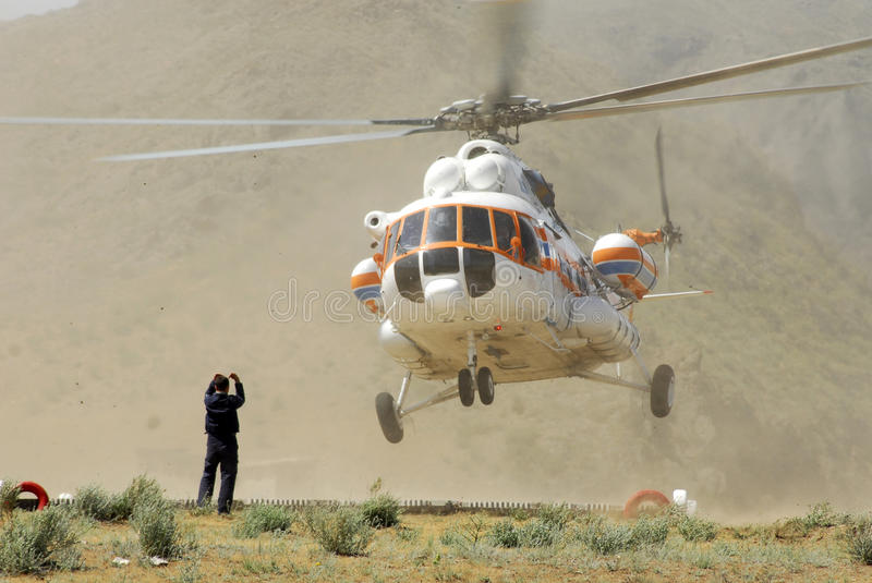 Helicopter make a landing stock photo