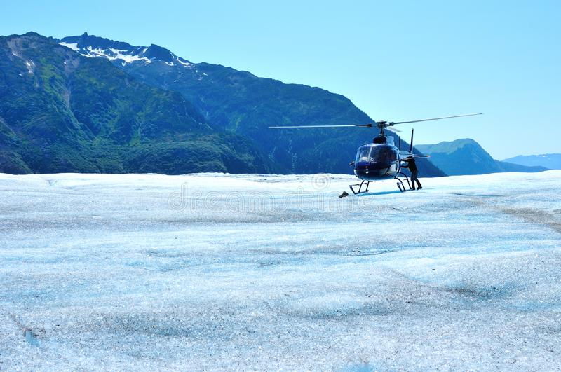 Helicopter on Mendenhall Glacier in Juneau Alaska royalty free stock photography