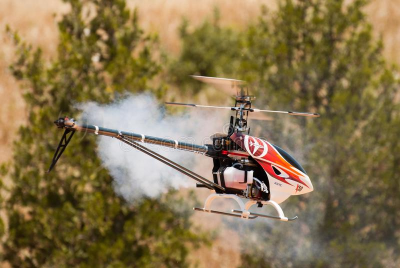 A helicopter model in flight stock image