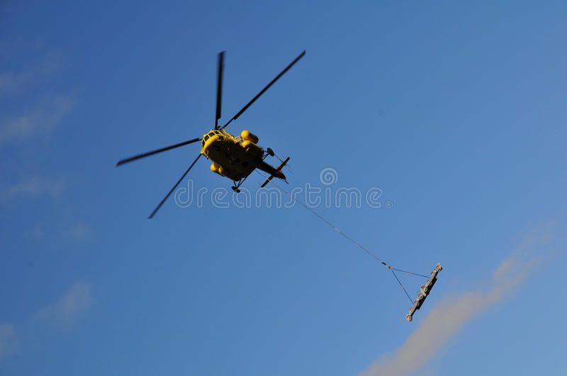 Helicopter mounting (wire-rope pulley battery) stock photo