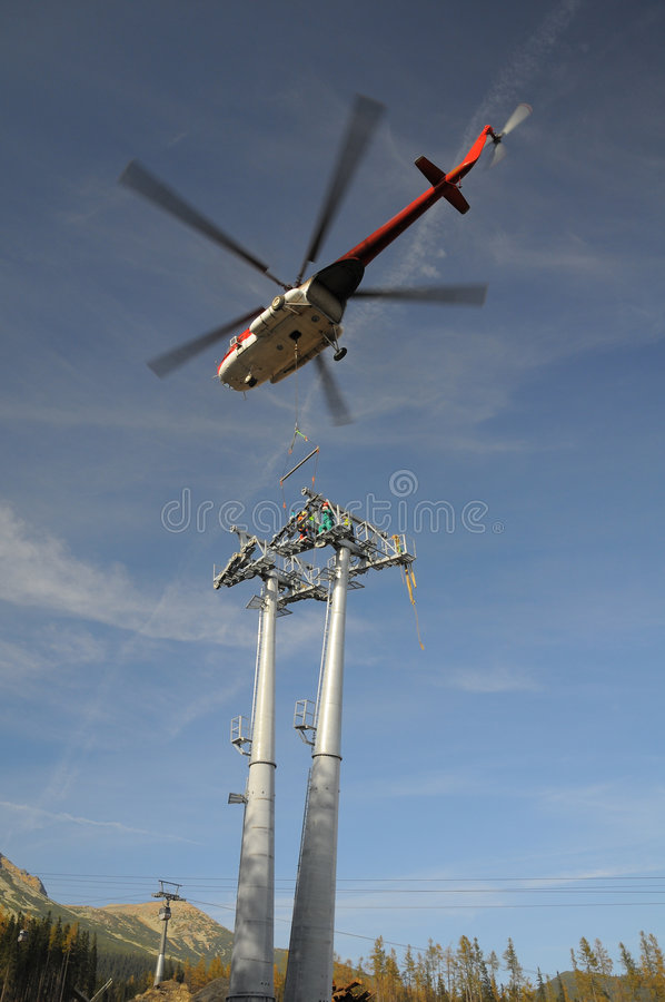 Helicopter mounting (wire-rope pulley battery) royalty free stock photography