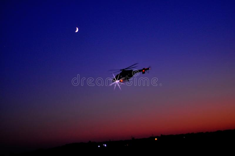 Helicopter night flight. Against the evening sky royalty free stock photo