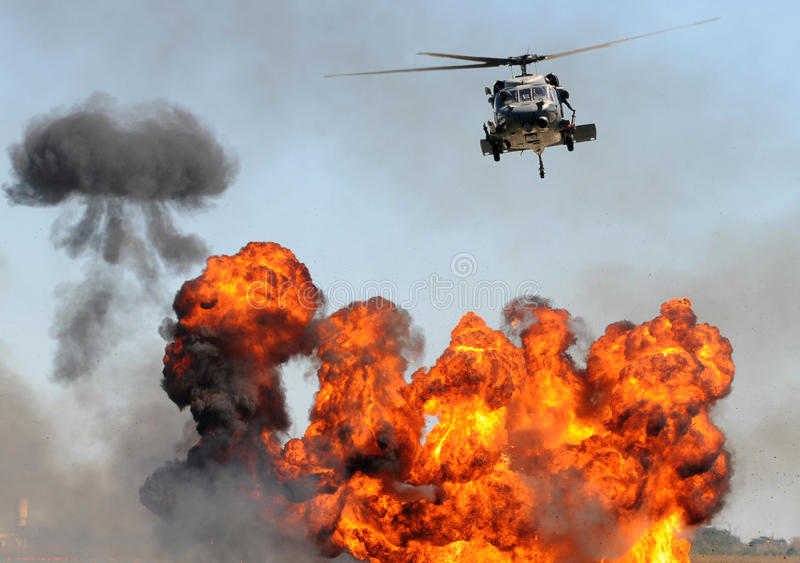 Helicopter Over Fire Stock Photo