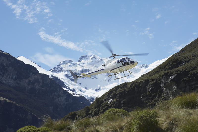 Helicopter Over Mountains stock images