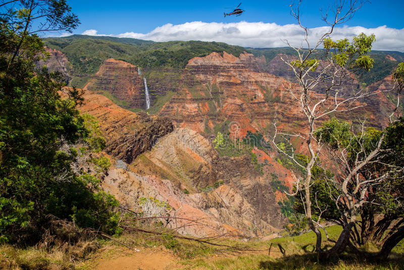 Helicopter over waimea canyon stock images