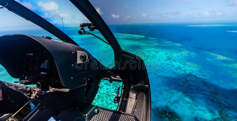 Helicopter ride over the Great Barrier Reef in Australia. Helicopter ride over Moore Reef, part of the outer Great Barrier Reef in Australia stock images