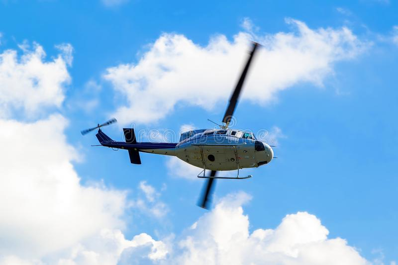 Helicopter. Shot of helicopter on a blue sky stock images