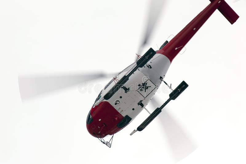 A helicopter in the sky stock photo