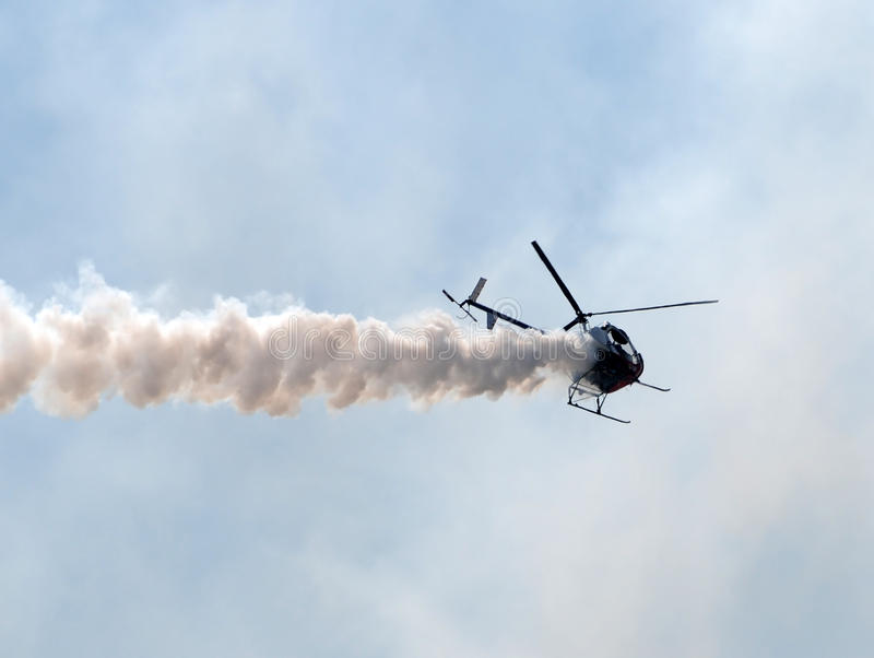 Helicopter with smoke stock photos