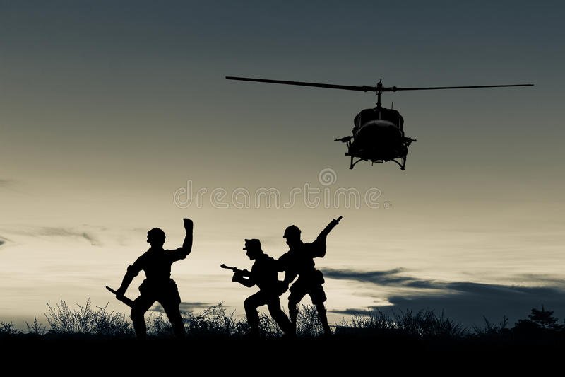 Helicopter and soldier silhouette royalty free stock images