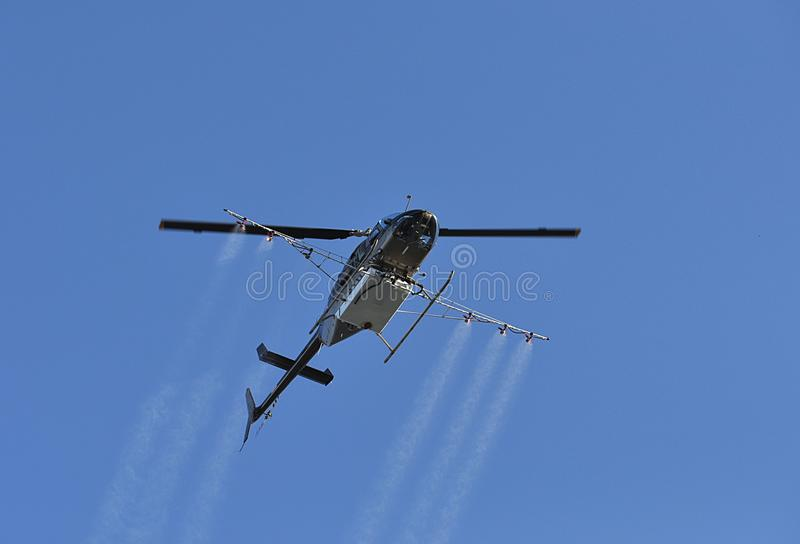 Helicopter Spraying Pesticide stock image
