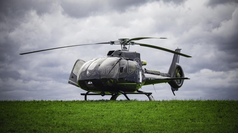 Helicopter standing on the green grass royalty free stock image