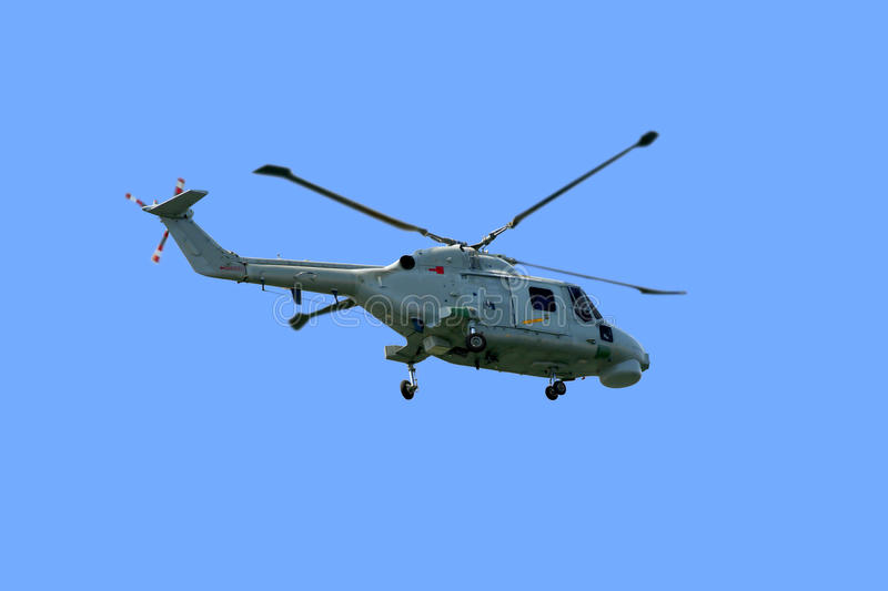 Helicopter - Super Linx MK95. A close view from an Westland Super Navy Lynx MK95 anti-submarine helicopter taking off under a beautiful clean blue sky royalty free stock photo