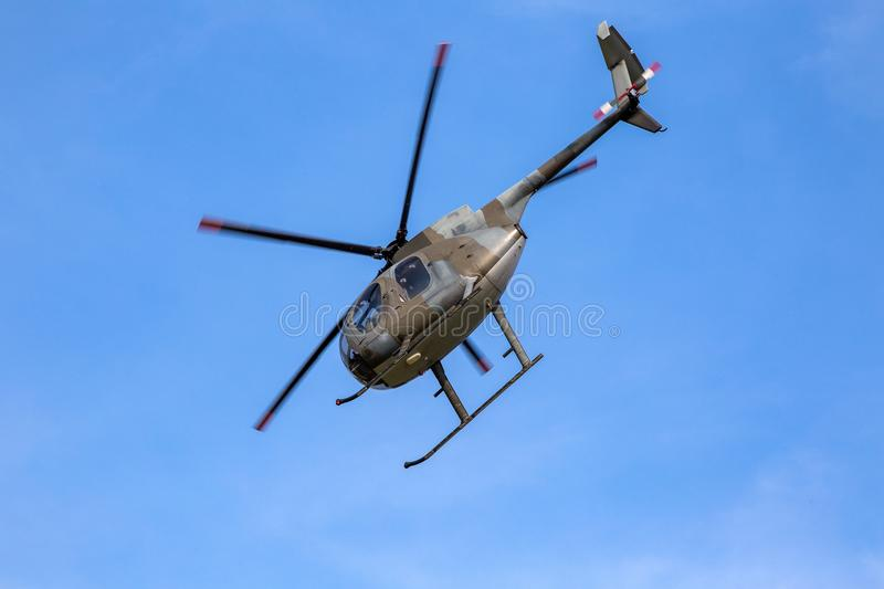 Helicopter taking off under a clear sky stock images