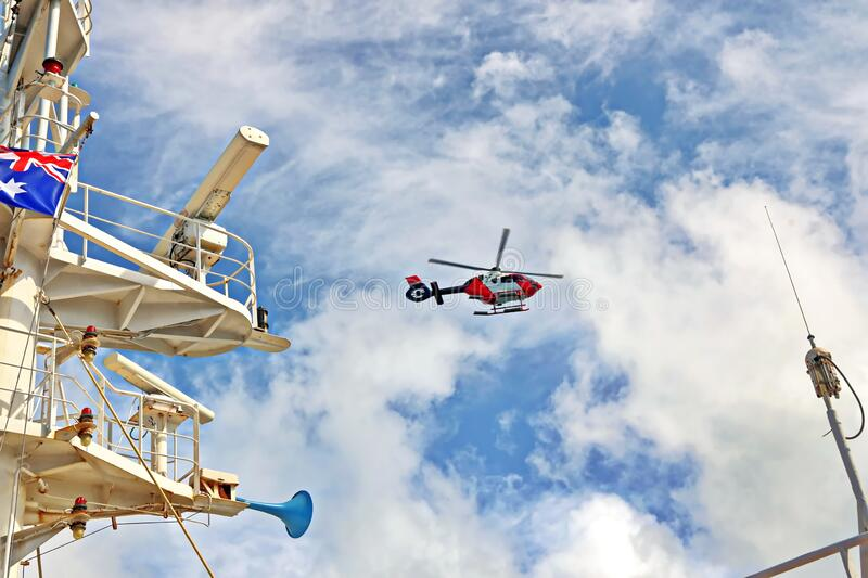 A helicopter used to receive a pilot on a sea vessel. Gladstone QLD, Australia. December.2019 stock photo