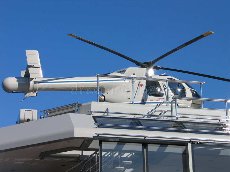 Helicopter on a yacht. Landing pod stock photography