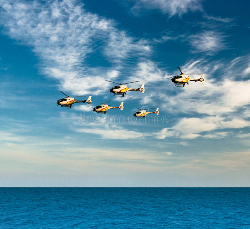 Helicopters of aerobatic team Patrulla Aspa stock image