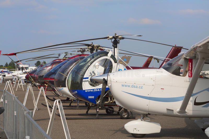 Helicopters lined up on the runway next to each other during the exhibition. stock photo