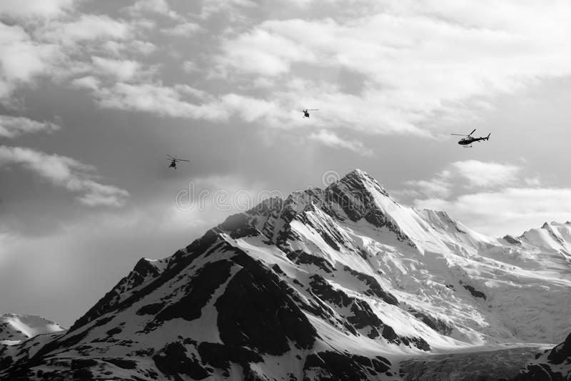Helicopters with Mountain Peaks royalty free stock photos