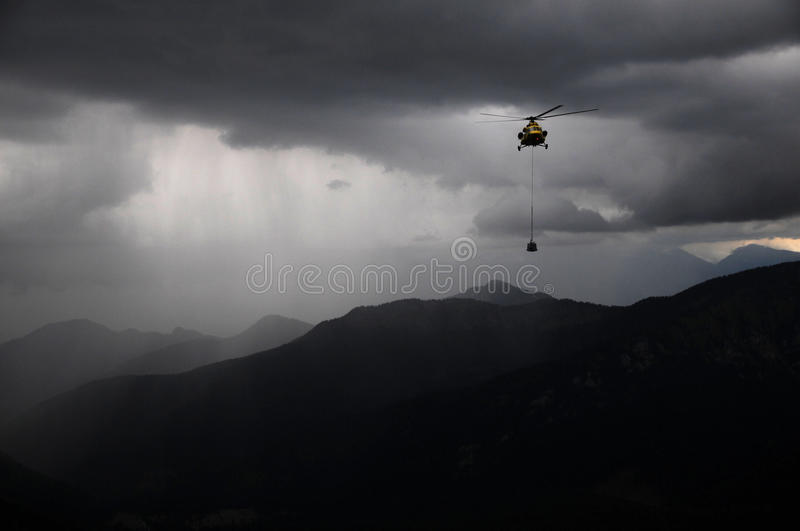 Helicopters in the rain stock image