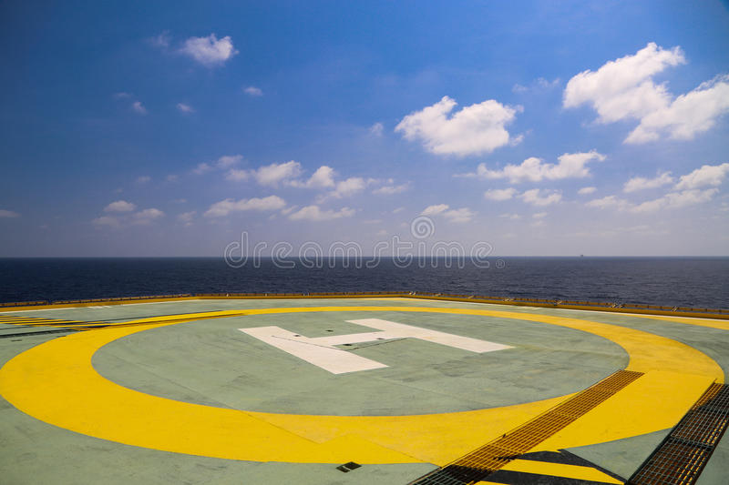 Helideck of oil and gas drilling rig in offshore industry, Helicopter landing area on construction platform in offshore. Of oil and gas industry or energy royalty free stock photo