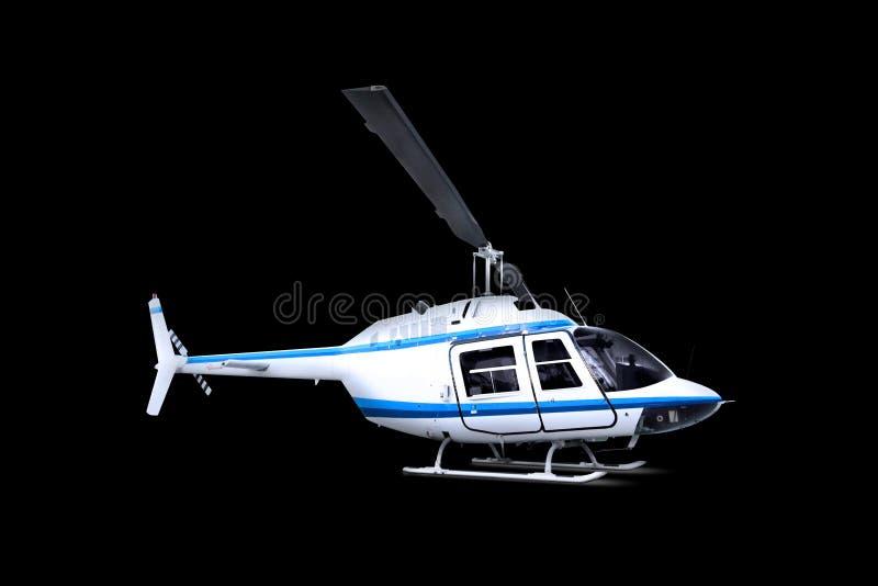 Helikopter die over zwarte wordt geïsoleerd stock foto's