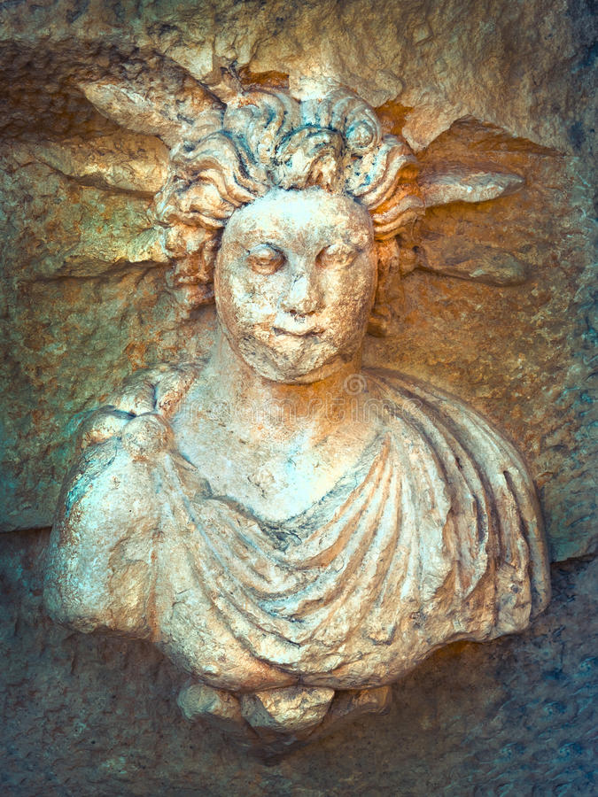 Helios. Sun god in a Greek mythology. God Mithras on relief - mystery religion Mithraism in a Greeks and Romans period royalty free stock photo
