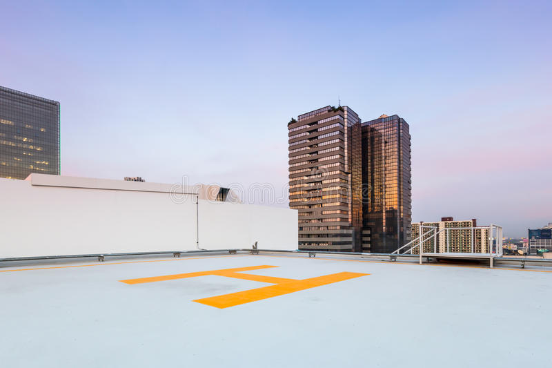 Helipad for helicopter on roof top building for people transport stock image