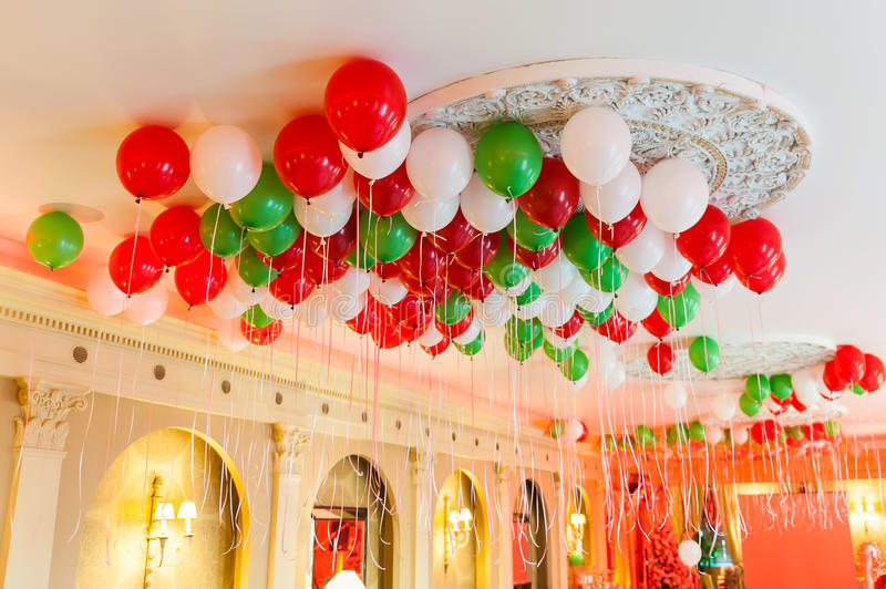 Helium Balloons on Ceiling. Helium party balloons on the ceiling in a banquet hall royalty free stock image