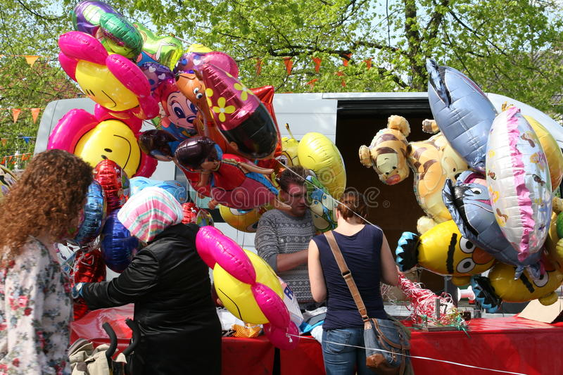 Helium balloon toys for children, Baarn, Netherlands. Helium balloons are very nice for the children and can be bought at this market stand in Baarn, the royalty free stock image