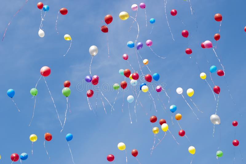 Helium balloons fly in the sky stock images