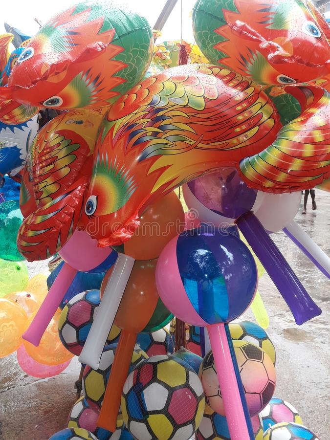 Helium Colourful balloons toys for children in street market. Helium balloons are very nice for the children royalty free stock image