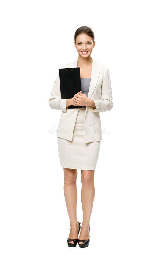 Hellång stående av affärskvinnan med dokument arkivbilder