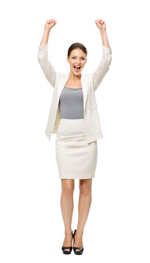 Hellång stående av affärskvinnan med händer upp arkivfoton