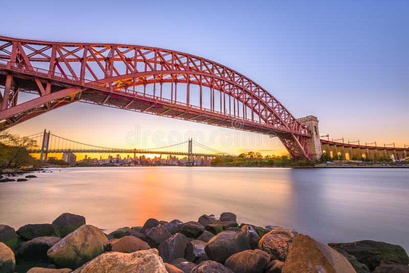 Hell Gate Bridge in New York City. New York, New York, USA at Hell Gate Bridge at sunset over the East River royalty free stock image