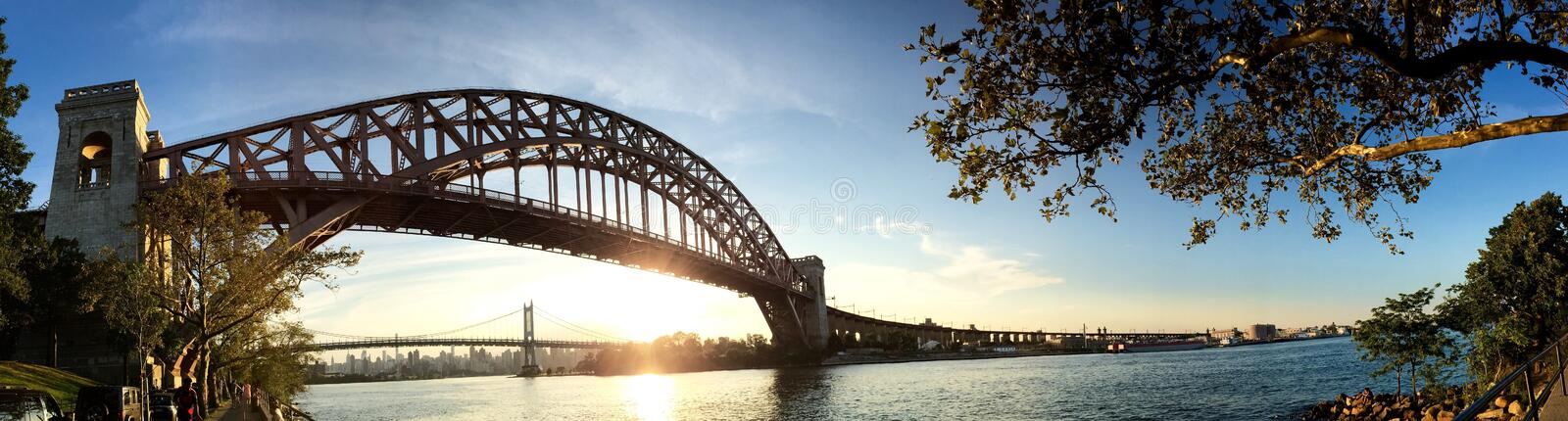 The Hell Gate Bridge and sunset sky royalty free stock image
