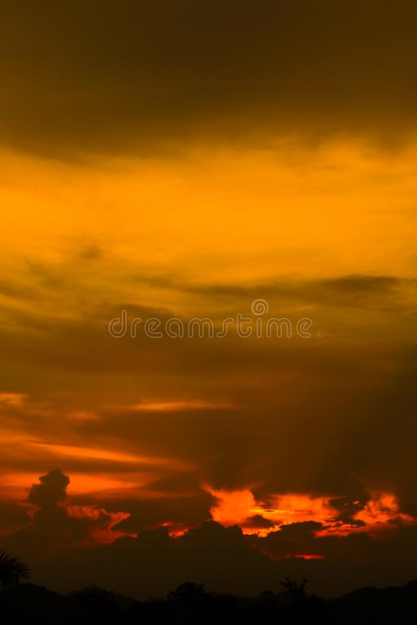 Hell in Heaven colorful Clouds Silhouette blue Sky Background Evening golden sunset stock image