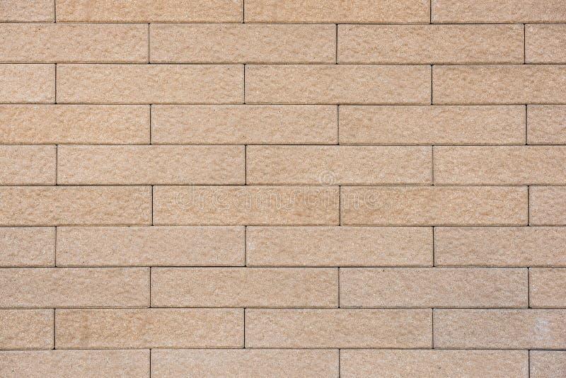 Hellbraune Farbbacksteinmauerbeschaffenheit als Hintergrund lizenzfreie stockfotografie