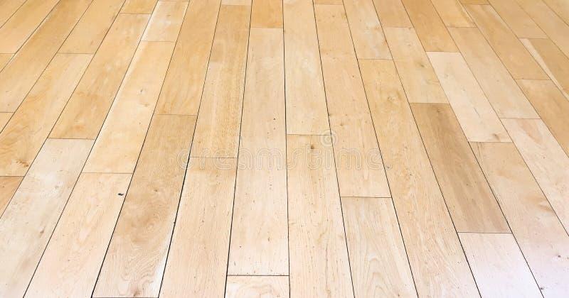 Hellbraune weiche Holzfußbodenoberflächenbeschaffenheit als Hintergrund, lackiertes hölzernes Parkett Alter Schmutz wusch lamelle lizenzfreie stockfotos