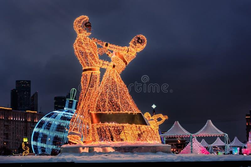Helle Beleuchtung in Form eines tanzenden Paares lizenzfreies stockfoto