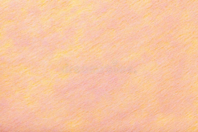 Helle Koralle und rosa Hintergrund des Filzgewebes Beschaffenheit des woolen Gewebes lizenzfreies stockbild