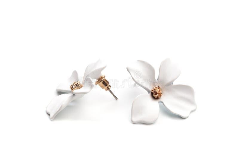 Helle Ohrringe lokalisiert auf weißem Hintergrund - Bild lizenzfreies stockbild