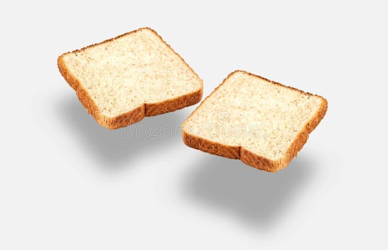 Helle Scheiben des integralen Brotes stockbilder