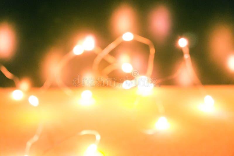 Helle unscharfe Lichtgirlande Warme Leuchte Auszug unscharfer Hintergrund stockfoto