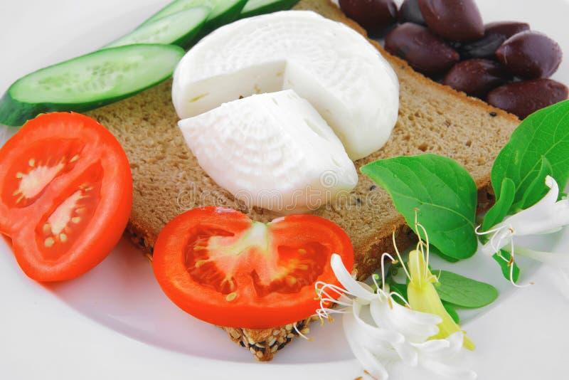 Heller Feta und Tomaten stockbilder