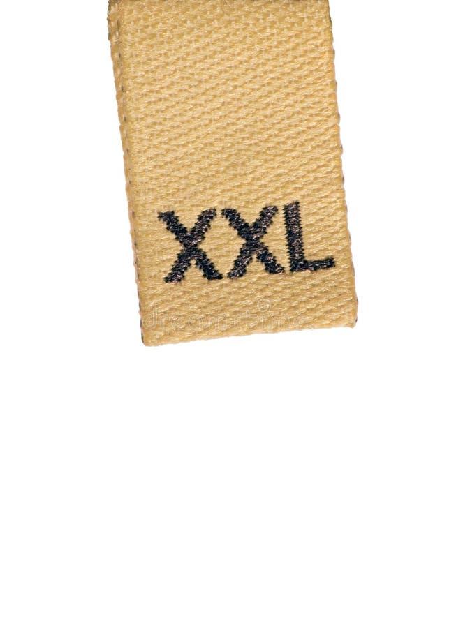 Heller Größen-Kleidungskennsatz des Makro XXL auf Weiß lizenzfreie stockfotos