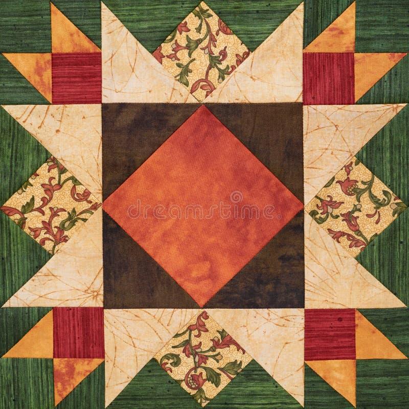 Heller orange-grüner geometrischer Patchworkblock von den Stücken Geweben stockfotografie