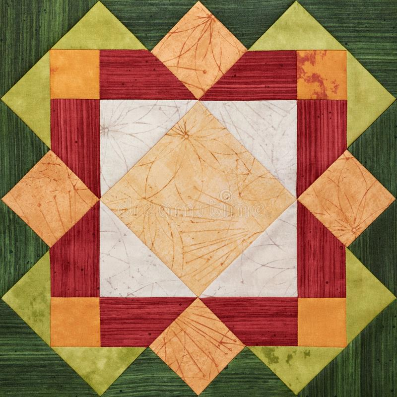Heller orange-grüner geometrischer Patchworkblock von den Stücken Geweben, Detail der Steppdecke stockfotos